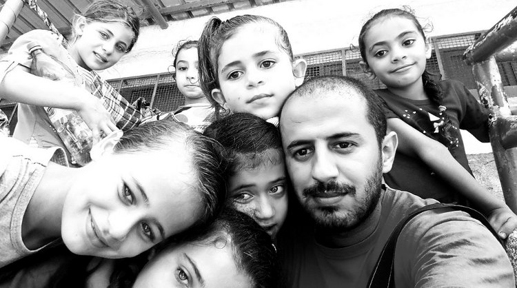 "My friend Bahaa Salman in Gaza, ""selfie of hope"" with the resilient kids of embattled Palestine - courtesy Bahaa"