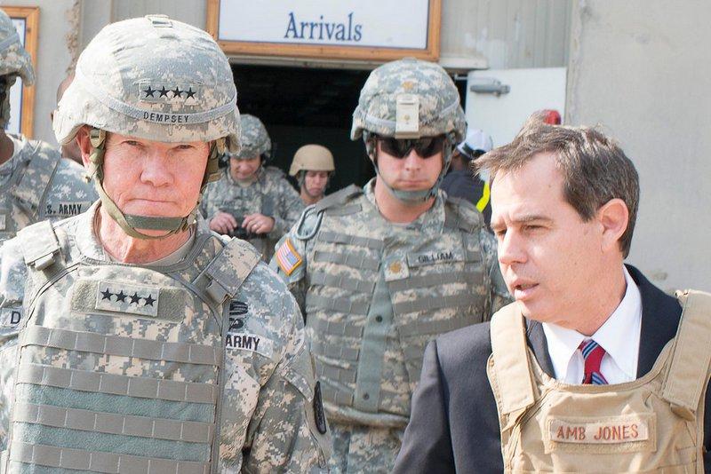 U.S. Ambassador to Iraq, Stuart E. Jones talks with U.S. Chairman of the Joint Chiefs of Staff, Gen. Martin E. Dempsey
