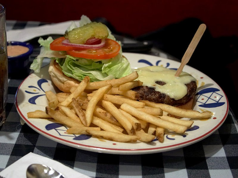 Hamburger and fries served in an American dinner. By John Sullivan