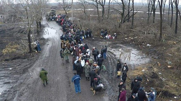From Graham Phillips on the front lines in east Ukraine - Refugees fleeing shelling fired upon by UAF forces.