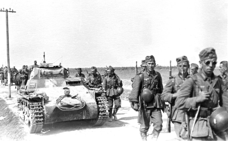 German Infranty along with a Panzer PzKpfw I light tank advancing towards the front lines of Operation Barbarossa 1941