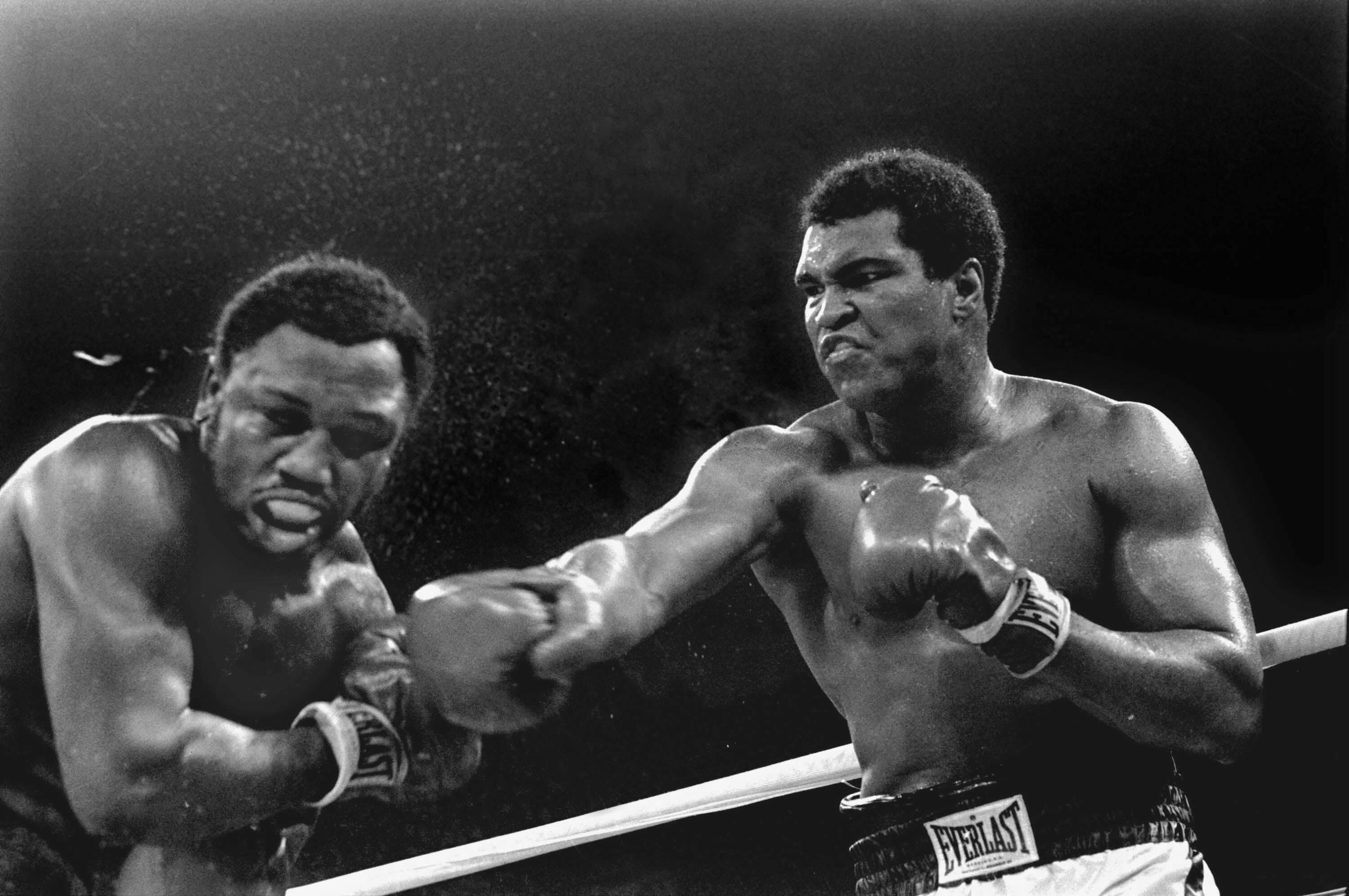 Spray flies from the head of challenger Joe Frazier - The Thriller in Manila