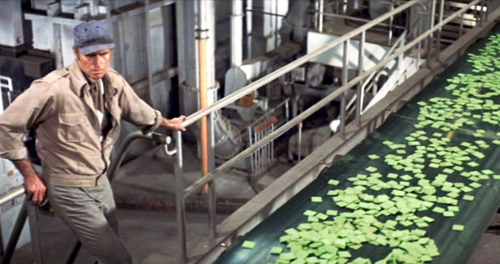 Charlton Heston looking at the Soylent Green conveyor belt