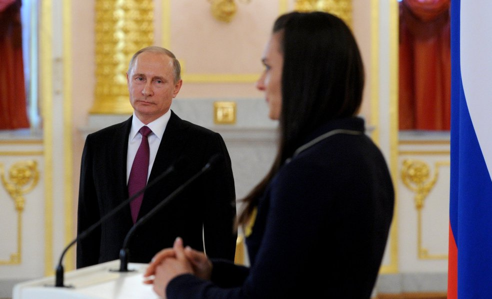 Putin and Yelena Isinbayeva, two-time Olympic champion, deliver a rousing challenge for Russia to compete well at Rio in spite of damaging western attacks