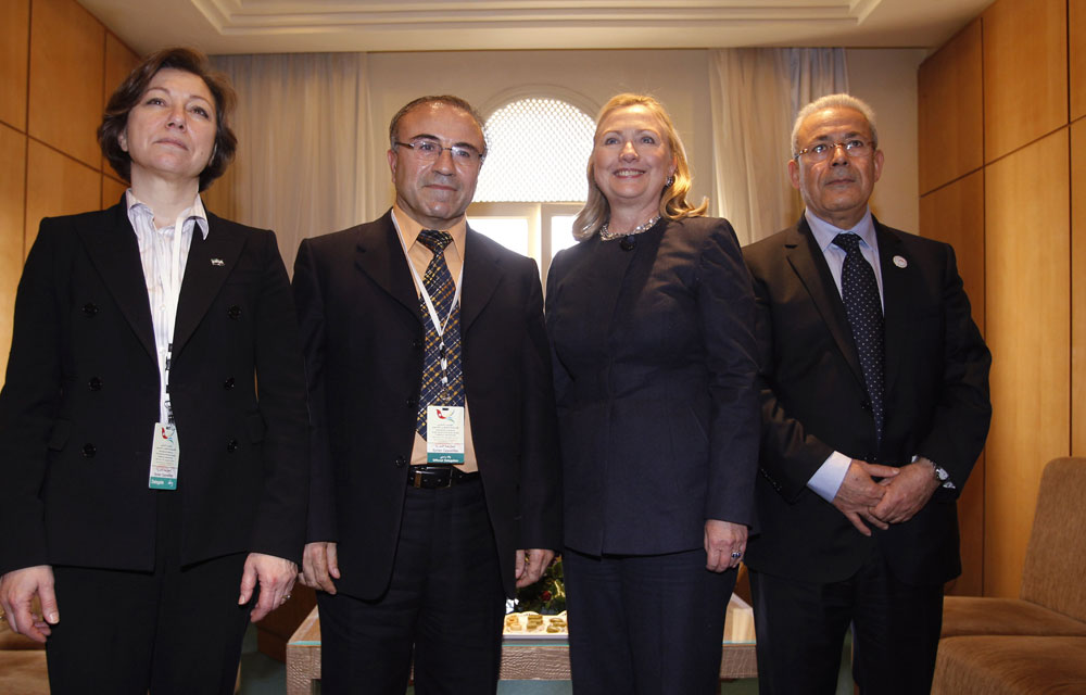 Bassma Kodmani with Clinton and other leaders demanding a military intervention in 2012