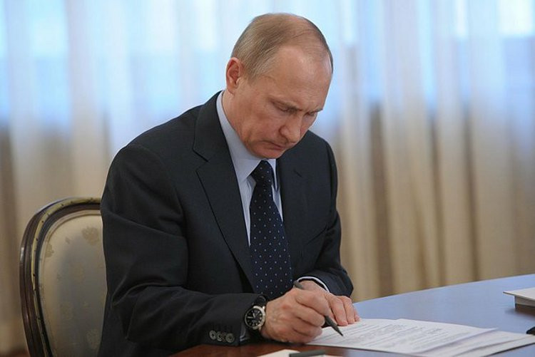 Vladimir Putin at his desk