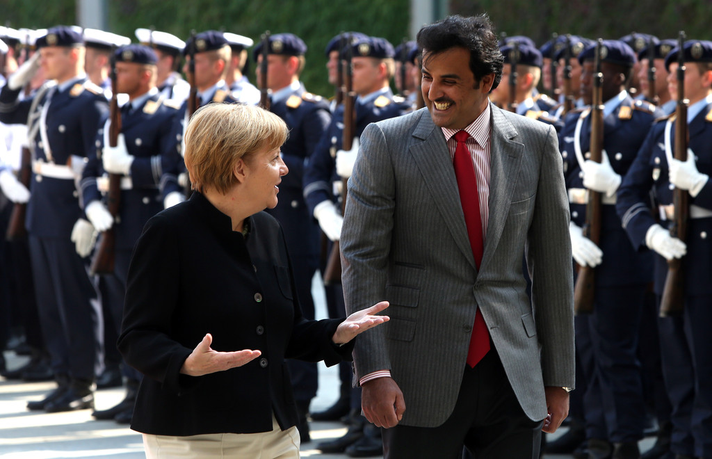 Germany's Angela Merkel cozy with Qatar's Emir Sheikh Tamim bin Hamad Al Thani